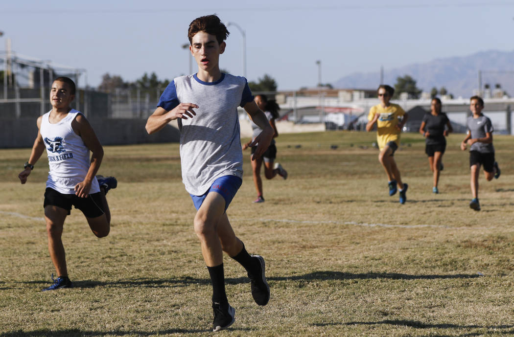 Valley's Donovan Jones, center left, during cross country practice at the high school in Las Vegas on Wednesday, Oct. 25, 2017. Chase Stevens Las Vegas Review-Journal @csstevensphoto