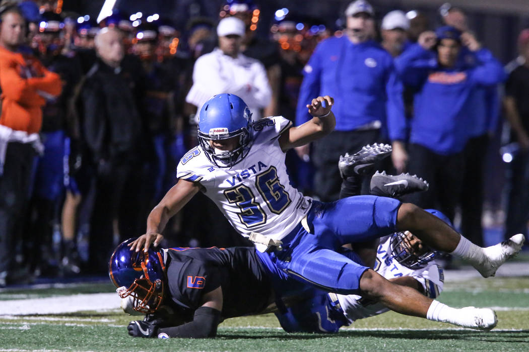 Bishop Gorman's Ikaika Ragsdale (6), left, is tackled by Sierra Vista during the first quarter of a football game at Bishop Gorman High School in Las Vegas, Thursday, Oct. 26, 2017. Joel Angel Jua ...