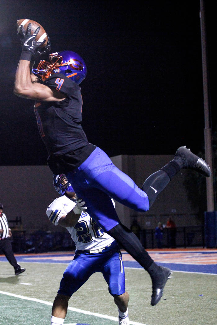 Bishop Gorman's Cedric Tillman (4) catches a pass before running into the end zone for a touchdown against Sierra Vista during the first quarter of a football game at Bishop Gorman High School in  ...