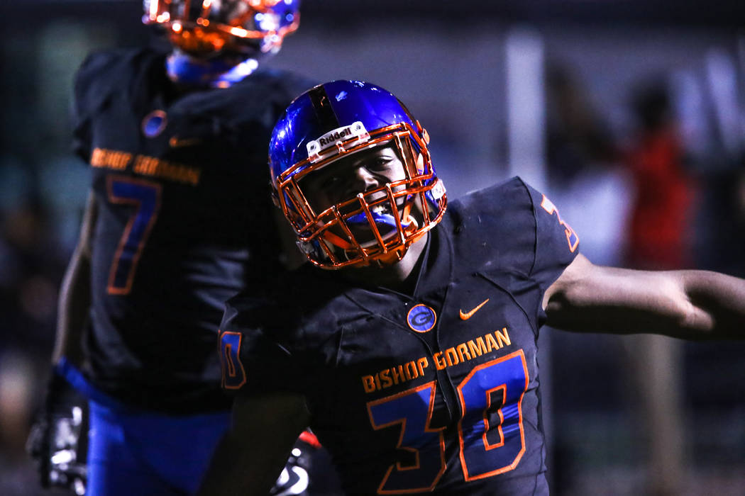 Bishop Gorman's Jeffrey Ulofoshio (30) celebrates after a fumble recovery against Sierra Vista during the third quarter of a football game at Bishop Gorman High School in Las Vegas, Thursday, Oct. ...