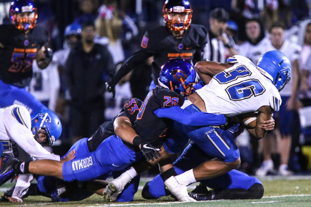 Sierra Vista's Kaika Faatiliga (36), right, is tackled by Bishop Gorman's defense during the fourth quarter of a football game at Bishop Gorman High School in Las Vegas, Thursday, Oct. 26, 2017. B ...