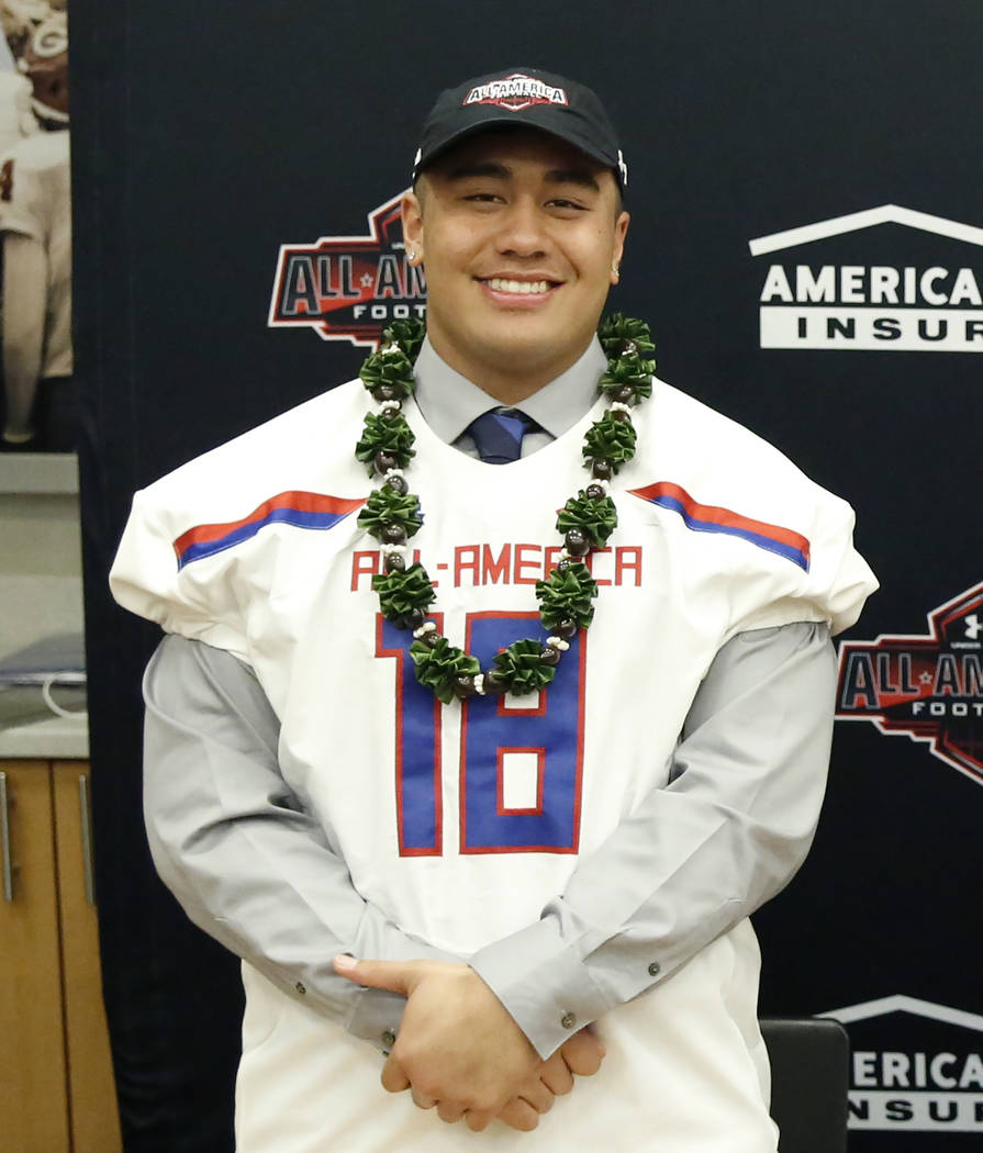 Bishop Gorman's offensive guard Jacob Isaia receives his honorary All America Game jersey at his school Wednesday, Oct. 25, 2017, in Las Vegas. Bizuayehu Tesfaye Las Vegas Review-Journal @bizutesfaye