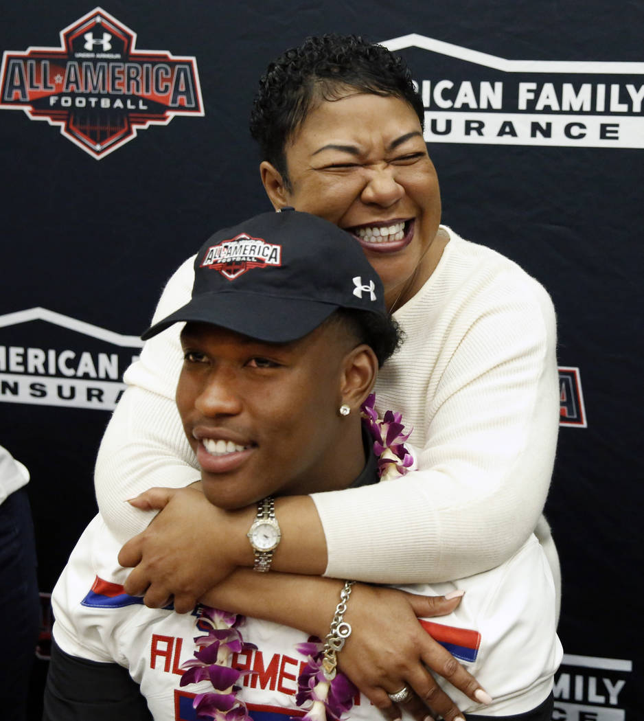 Bishop Gorman's tight end Brevin Jordan, with his mother Beverley after receiving his honorary All America Game jersey at his school Wednesday, Oct. 25, 2017, in Las Vegas. Bizuayehu Tesfaye Las V ...