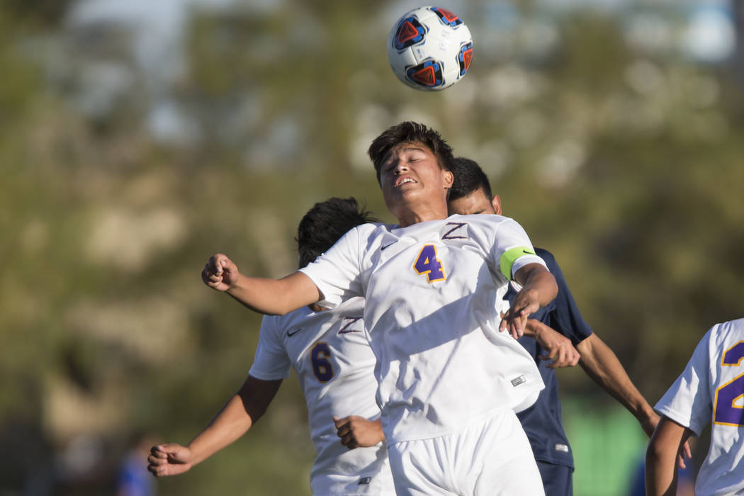 Durango's Gael Delangel-Parra (4) leaps for the ball in the playoff soccer game against Legacy at the Bettye Wilson Soccer Complex in Las Vegas, Thursday, Nov. 2, 2017. Durango won 5-1. Erik Verdu ...