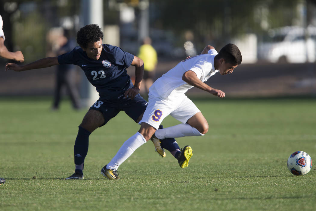 Durango's Jaime Munguia (9) is fouled by Legacy's Jose Miranda (23) in the playoff soccer game at the Bettye Wilson Soccer Complex in Las Vegas, Thursday, Nov. 2, 2017. Durango won 5-1. Erik Verdu ...