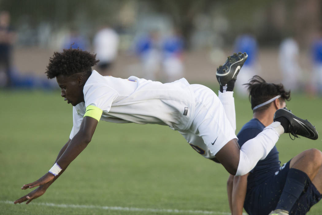 Durango's Mihreteab Tesfamariam (10) is tackled in the playoff soccer game against Legacy at the Bettye Wilson Soccer Complex in Las Vegas, Thursday, Nov. 2, 2017. Durango won 5-1. Erik Verduzco L ...