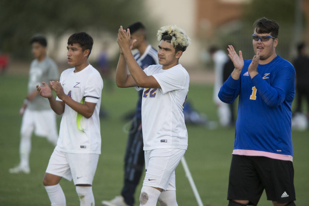 Durango's Gael Delangel-Parra (4), Cristian De Leon Morales (22) and Nikolas Todorovich (1) celebrate their victory in the playoff soccer game against Legacy at the Bettye Wilson Soccer Complex in ...
