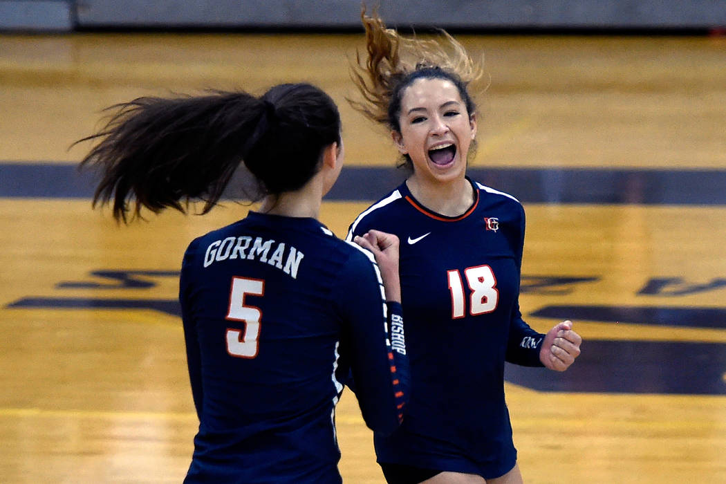 Bishop Gorman's Sydney Lobato (5) and Sarah Lychock react after a point against Shadow Ridge during a class 4A Sunset Region final volleyball game at Durango High School Friday, Nov. 3, 2017, in L ...