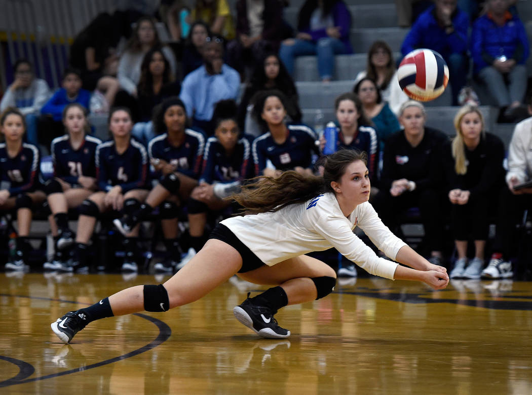 Bishop Gorman's Makenna Gordon digs for the ball against Shadow Ridge during a class 4A Sunset Region final volleyball game at Durango High School Friday, Nov. 3, 2017, in Las Vegas. Bishop Gorman ...