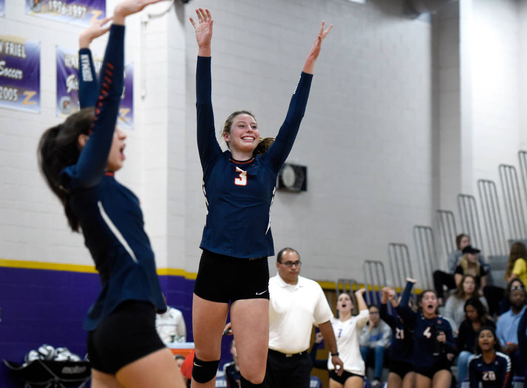 Bishop Gorman's Sydney Lobato, left, and Tommi Stockham reacts after a point against Shadow Ridge during a class 4A Sunset Region final volleyball game at Durango High School Friday, Nov. 3, 2017, ...