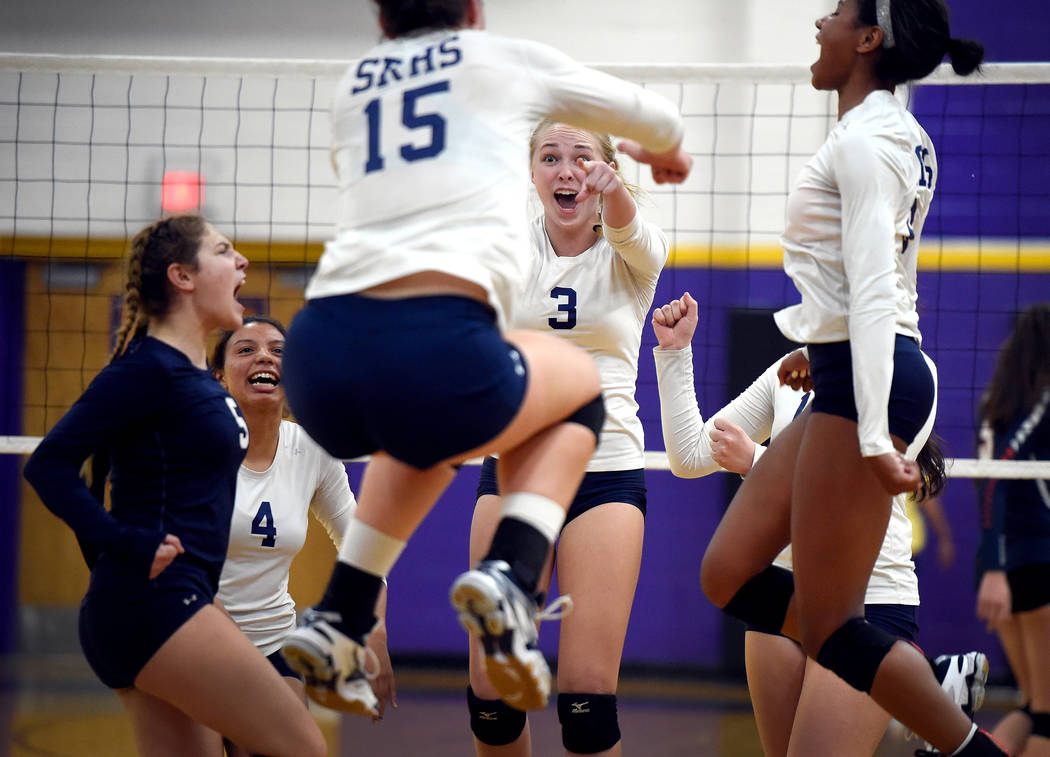Shadow Ridge's from left, Braedyn Peters, Kizzy Rodriguez, Whittnee Nihipali, Madison Norr and Alysha Smith reacts after a point against Bishop Gorman during a class 4A Sunset Region final volleyb ...