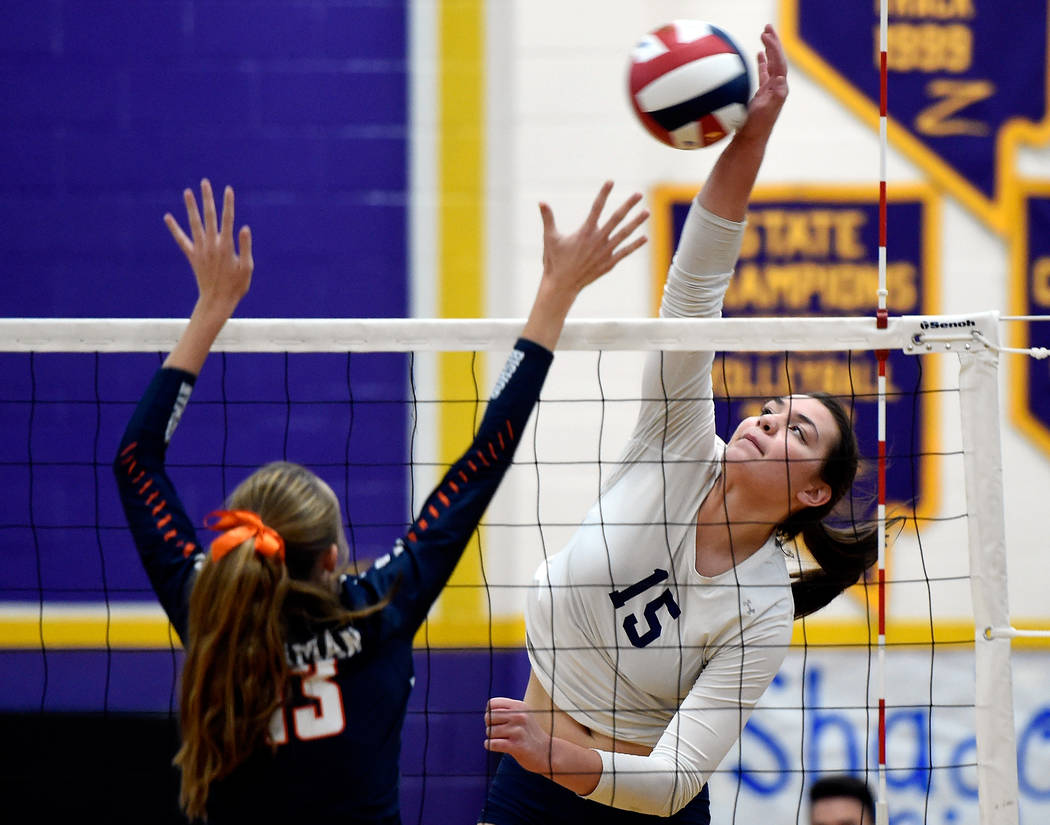 Shadow Ridge's Whittnee Nihipali hits the ball against Bishop Gorman's Angelina Starck during a class 4A Sunset Region final volleyball game at Durango High School Friday, Nov. 3, 2017, in Las Veg ...