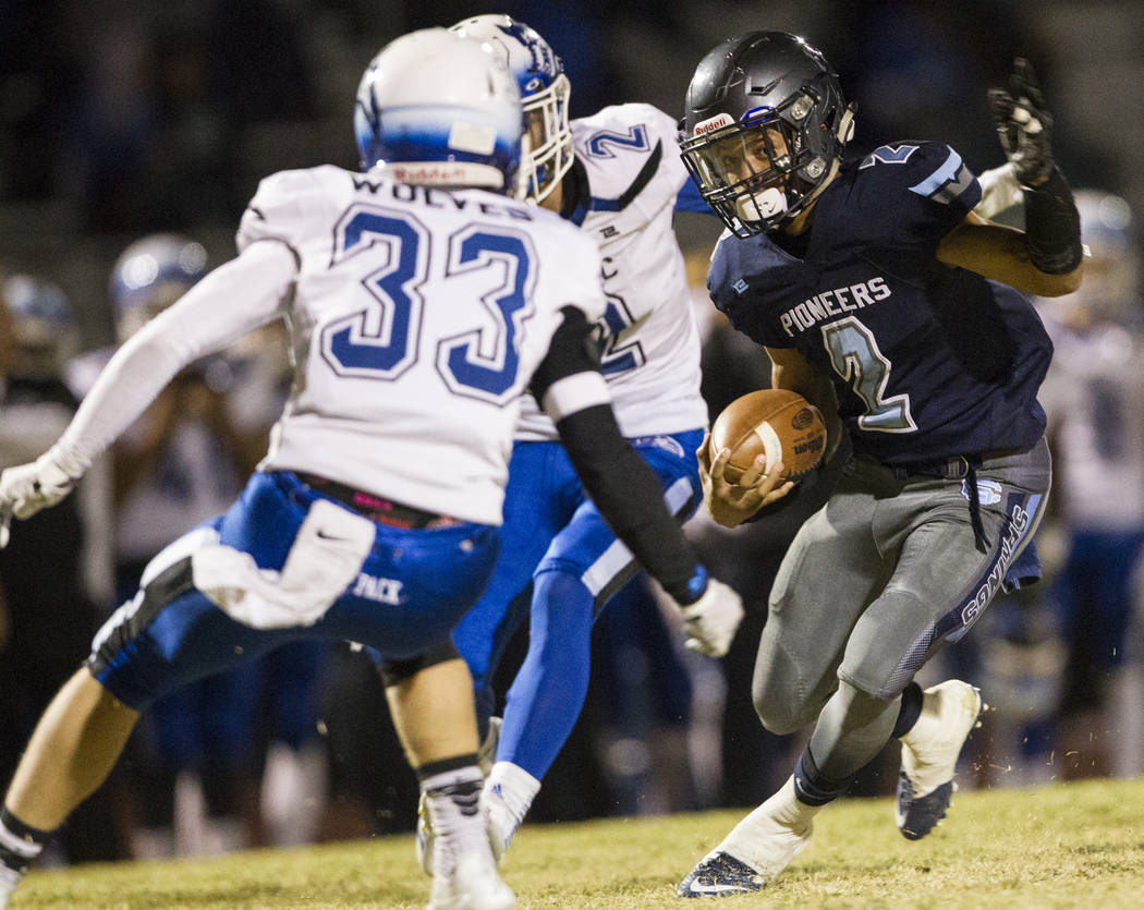 Canyon Spring's DiaMante Burton (2) runs the ball against Basic during their playoff football game at Canyon Spring High School in Las Vegas, Friday, Nov. 3, 2017. Erik Verduzco Las Vegas Review-J ...