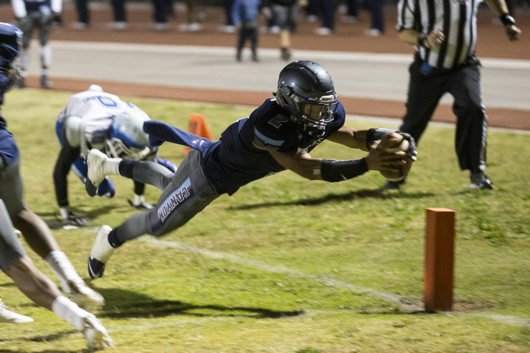 Canyon Spring's DiaMante Burton (2) runs the ball for a touchdown against Basic during their playoff football game at Canyon Spring High School in Las Vegas, Friday, Nov. 3, 2017. Erik Verduzco La ...
