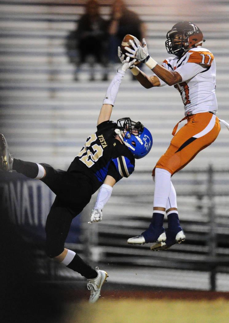 Legacy wide receiver Aubrey Washington catchs a pass as Sierra Vista safety Devin Gomez defends in the first half of their prep football game at Sierra Vista School in Las Vegas Friday November 3, ...