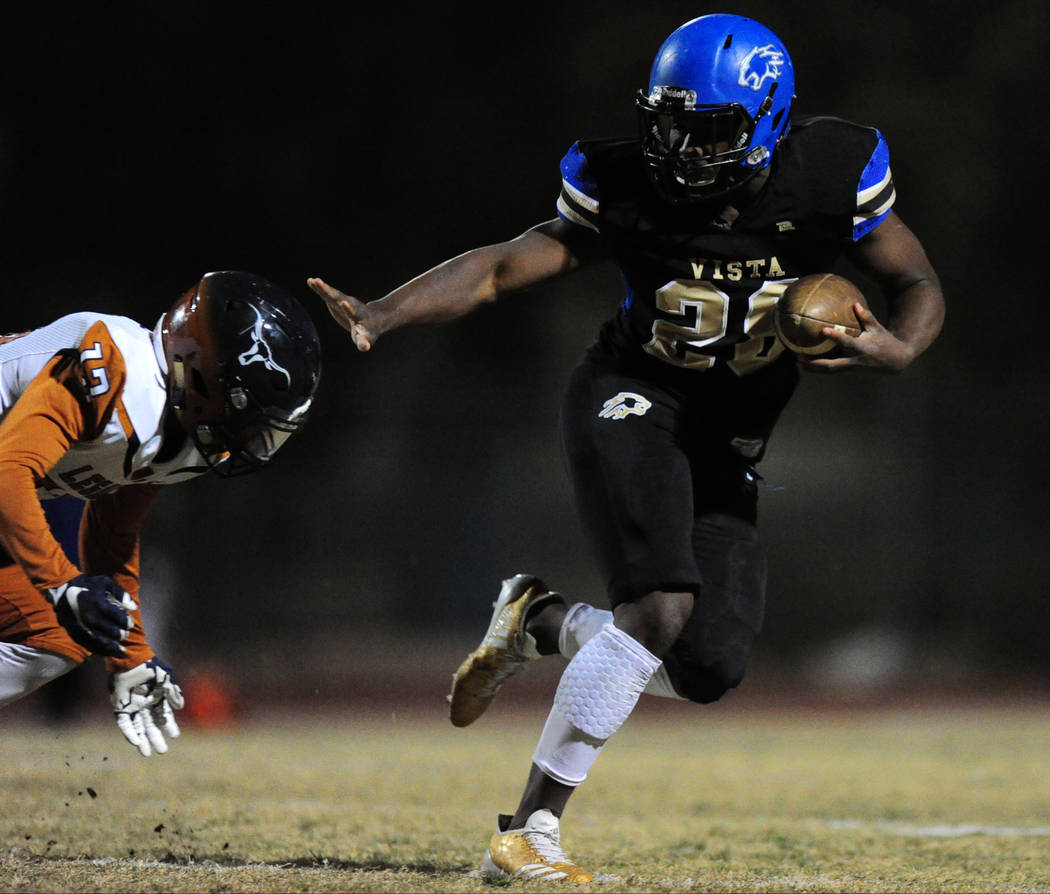 Sierra Vista running back Bryan LaGrange breaks the tackle of Legacy safety Andrew Gamble to score a touchdown in the first half of their prep football game at Sierra Vista School in Las Vegas Fri ...