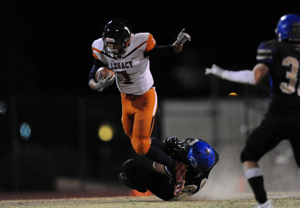 Sierra Vista safety Frank Hines makes a shoe-string tackle on Legacy running back Aubrey Washington in the first half of their prep football game at Sierra Vista School in Las Vegas Friday Novembe ...
