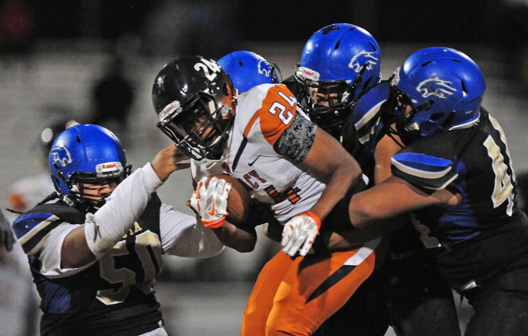 The Sierra Vista defense brings down Legacy running back Isaiah Whitehead (24) in the second half of their prep football game at Sierra Vista School in Las Vegas Friday November 3, 2017. Josh Holm ...