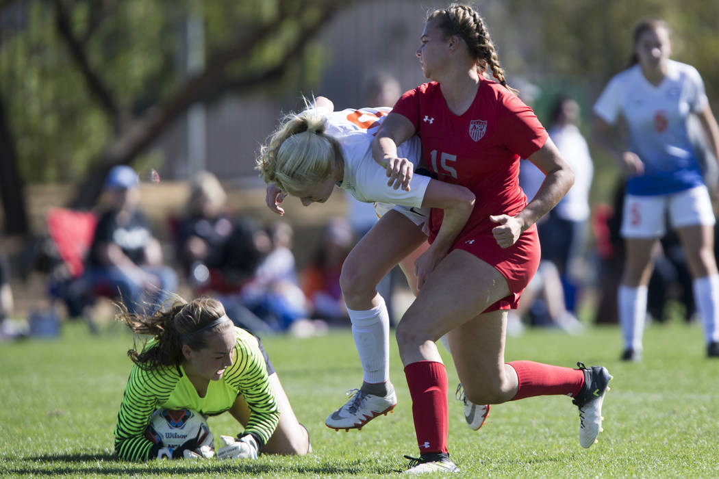 Bishop Gorman's Kevyn Hillegas (12) defends against Arbor View's Jolianna Meyers (15) in the Sunset Region girl's soccer championship game at the Bettye Wilson Soccer Complex in Las Vegas, Saturda ...