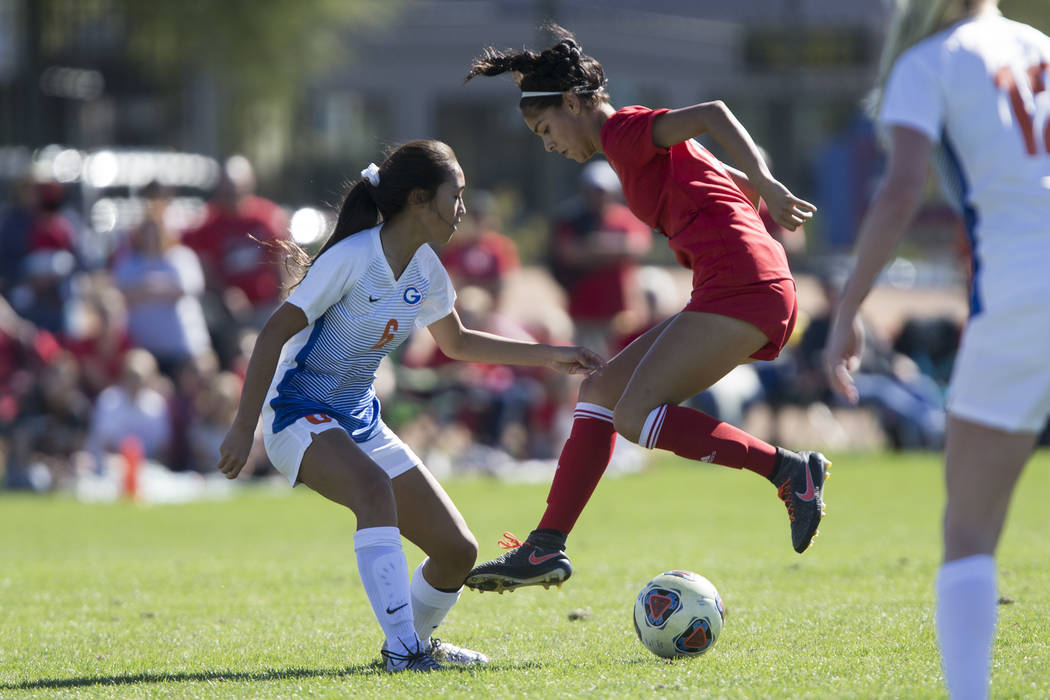 Bishop Gorman's Caitlyn Rueca (6) defends against Arbor View's Karissa Martinez (21) in the Sunset Region girl's soccer championship game at the Bettye Wilson Soccer Complex in Las Vegas, Saturday ...