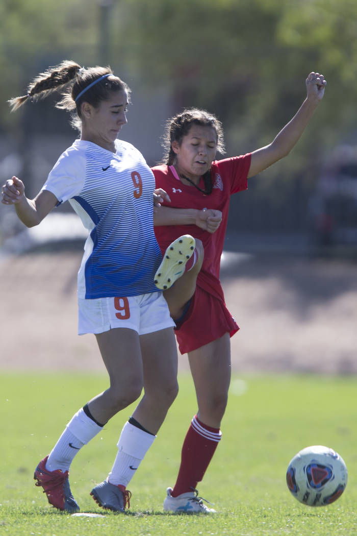 Bishop Gorman's Jaden Terrana (9) fights for the ball against Arbor View's Sierra Vicente (1) in the Sunset Region girl's soccer championship game at the Bettye Wilson Soccer Complex in Las Vegas, ...