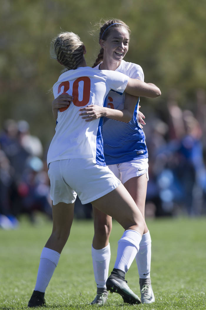 Bishop Gorman's Taylor Cox (16) celebrates her goal against Arbor View with her teammate Gianna Gourley (30) in the Sunset Region girl's soccer championship game at the Bettye Wilson Soccer Comple ...