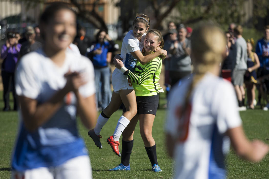 Bishop Gorman players Jaden Terrana (1), left, and Hannah Lee (27), celebrate their victory against Arbor View in the Sunset Region girl's soccer championship game at the Bettye Wilson Soccer Comp ...