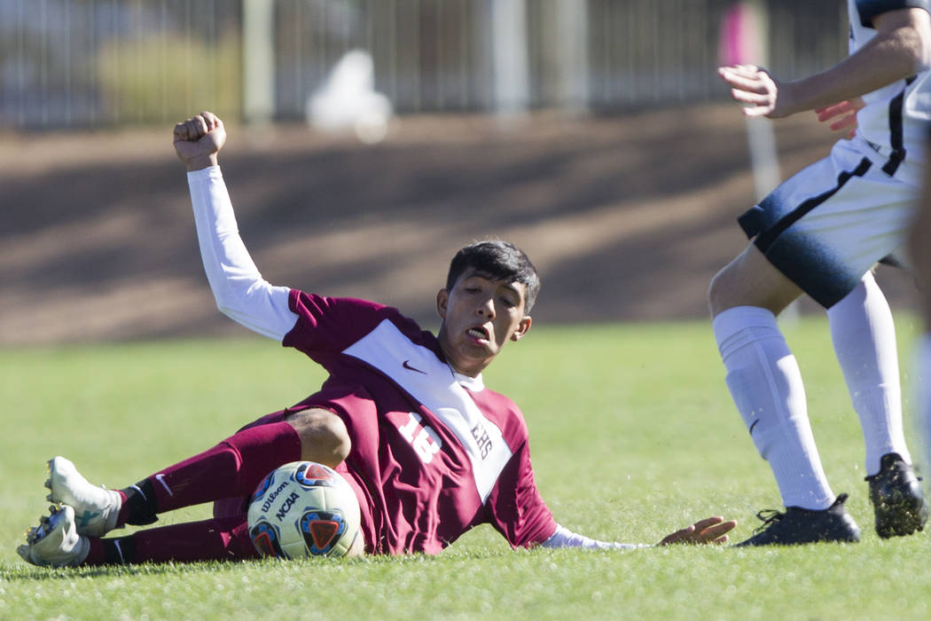 Eldorado's Cipriano Rodriguez (18) slides for the ball against Coronado in the Sunrise Region boy's championship soccer game at the Bettye Wilson Soccer Complex in Las Vegas, Saturday, Nov. 4, 201 ...