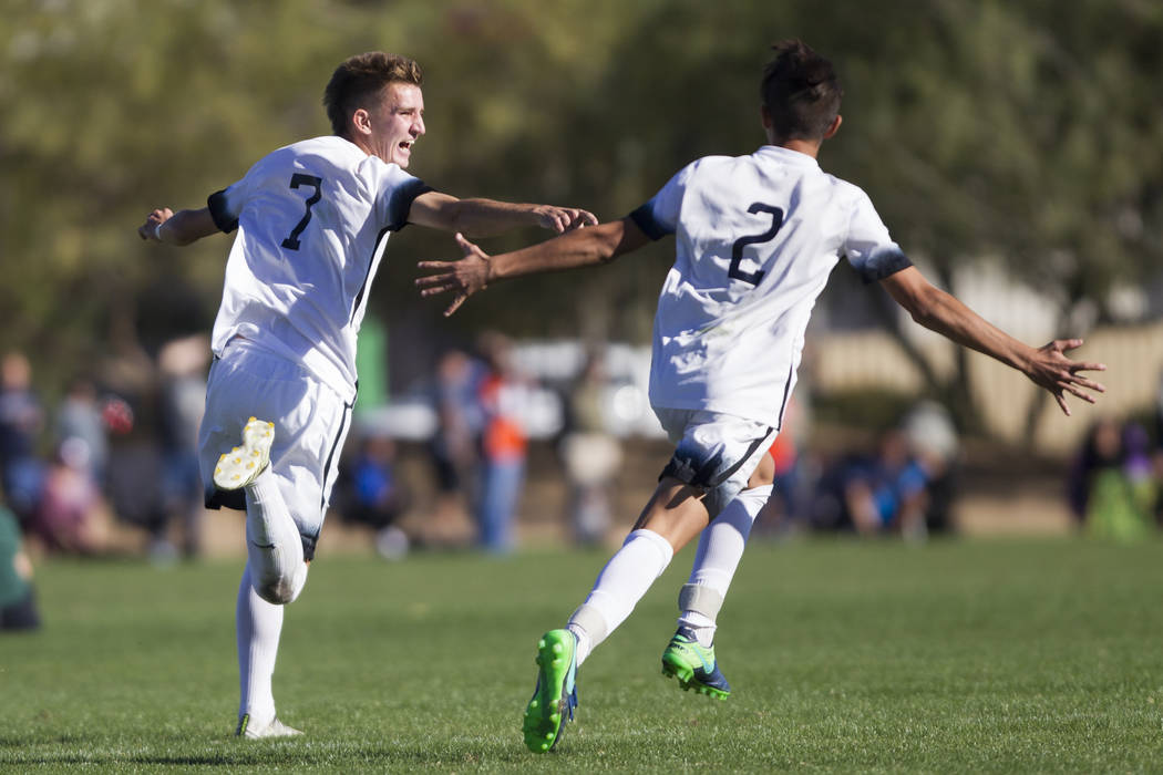 Coronado's John Lynam (7) celebrates his goal against Eldorado with his teammate Noah Velgos (2) in the Sunrise Region boy's championship soccer game at the Bettye Wilson Soccer Complex in Las Veg ...
