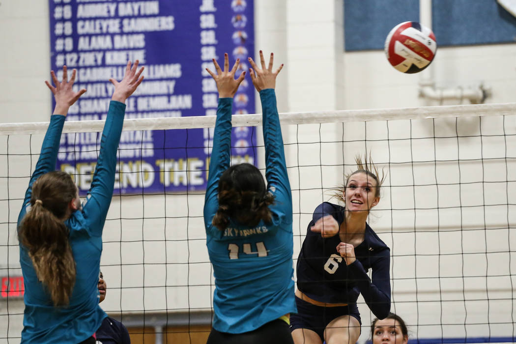 Shadow Ridge's Madyson Lousignont (6), right, hits the ball across the net during a volleyball game against Silverado at Sierra Vista High School in Las Vegas, Monday, Nov. 6, 2017. Shadow Ridge w ...