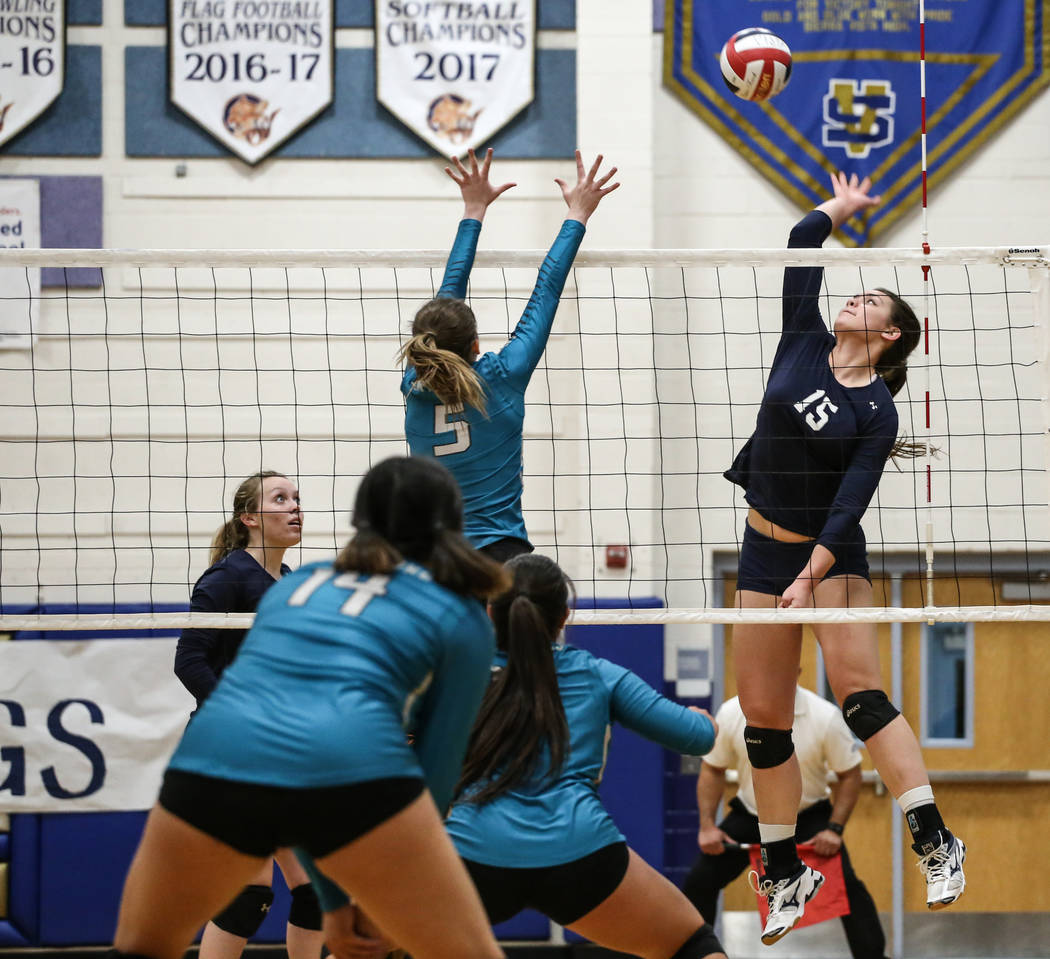 Shadow Ridge's Whittnee Nihipali (15), right, prepares to hit the ball during game one of a volleyball game against Silverado at Sierra Vista High School in Las Vegas, Monday, Nov. 6, 2017. Shadow ...