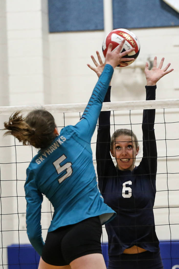 Silverado's Audrey Wood (5), left, hits the ball across the net as Shadow Ridge's Madyson Lousignont (6), right, jumps in an attempt to block it during game one of a volleyball game at Sierra Vist ...