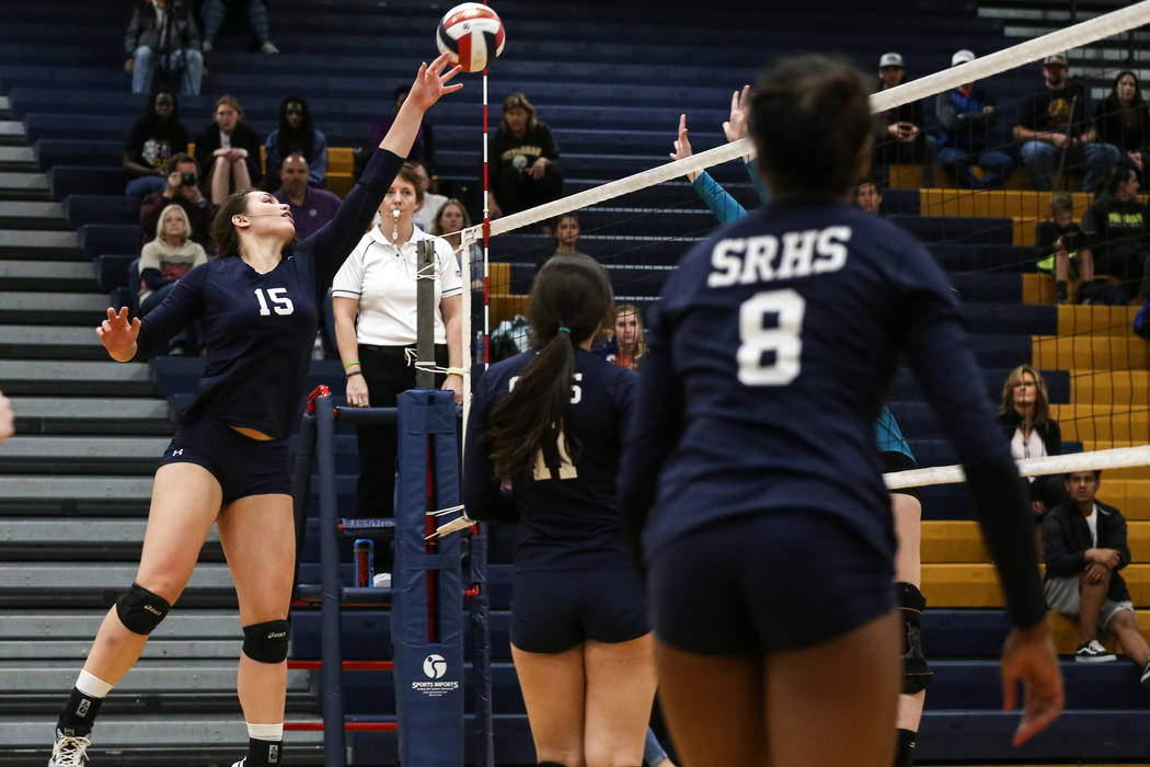 Shadow Ridge's Whittnee Nihipali (15), left, jumps as she hits the ball across the net during game two of a volleyball game against Silverado at Sierra Vista High School in Las Vegas, Monday, Nov. ...