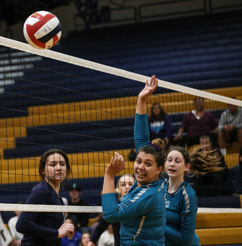 Silverado's Sydney Berenyi (11), center, looks at the ball as Shadow Ridge scores during game two of a volleyball game at Sierra Vista High School in Las Vegas, Monday, Nov. 6, 2017. Shadow Ridge  ...