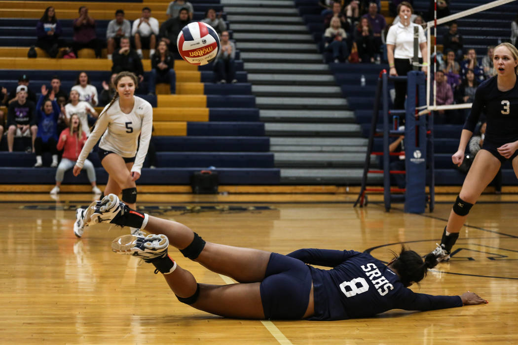 Shadow Ridge's Alysha Smith (8) dives after Silverado hit the ball across the net during game two of a volleyball game at Sierra Vista High School in Las Vegas, Monday, Nov. 6, 2017. Shadow Ridge  ...
