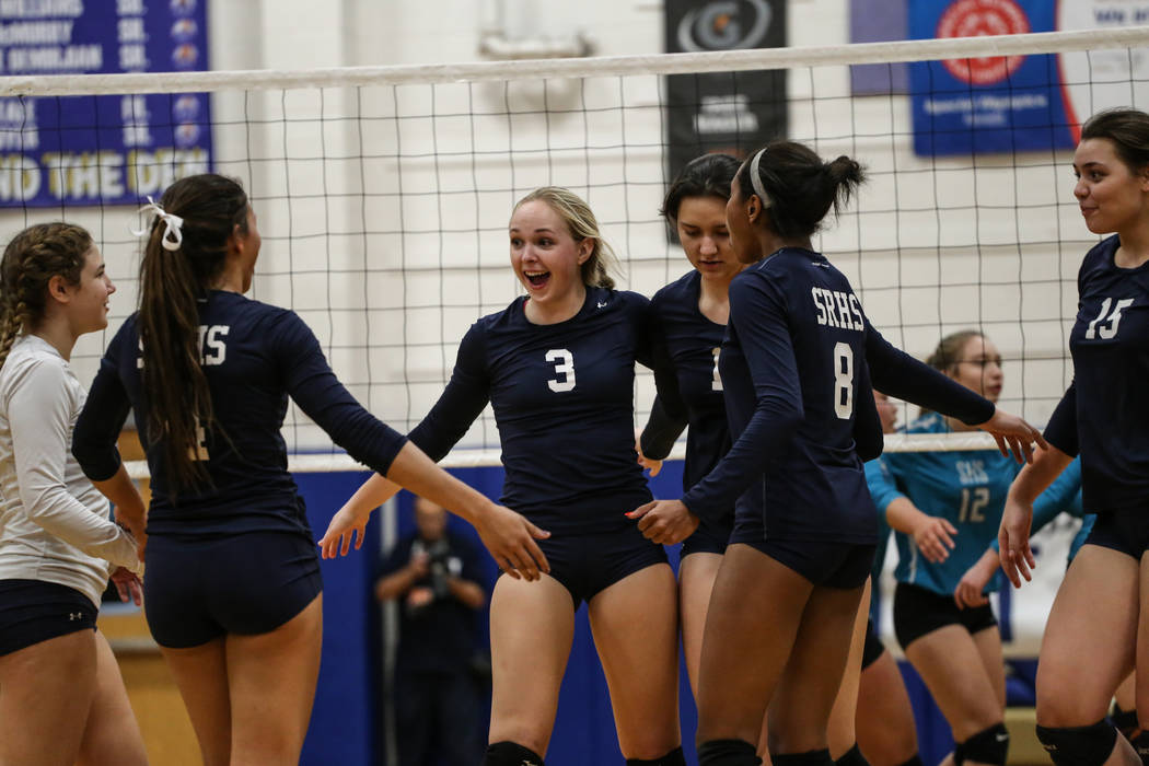 Shadow Ridge's Madison Norr (3) celebrates with teammates after scoring during game two of a volleyball game against Silverado at Sierra Vista High School in Las Vegas, Monday, Nov. 6, 2017. Shado ...