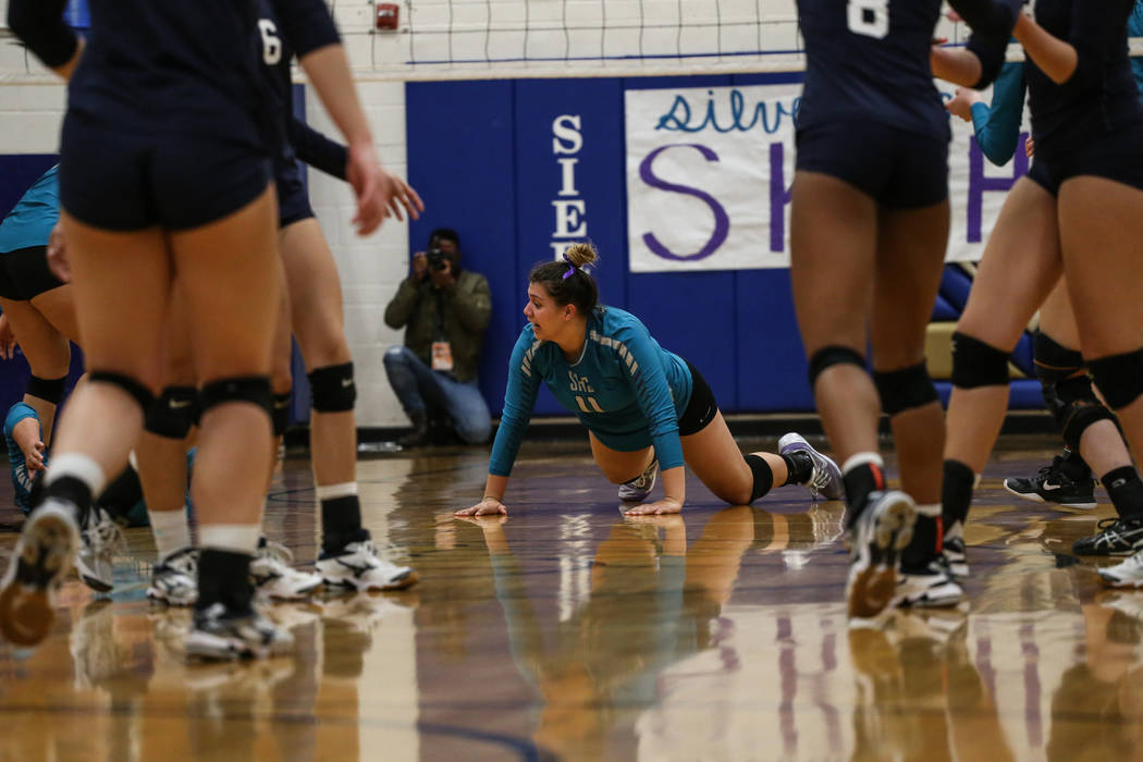 Silverado's Sydney Berenyi (11) touches the ground after being scored on by Shadow Ridge during game three of a volleyball game at Sierra Vista High School in Las Vegas, Monday, Nov. 6, 2017. Shad ...