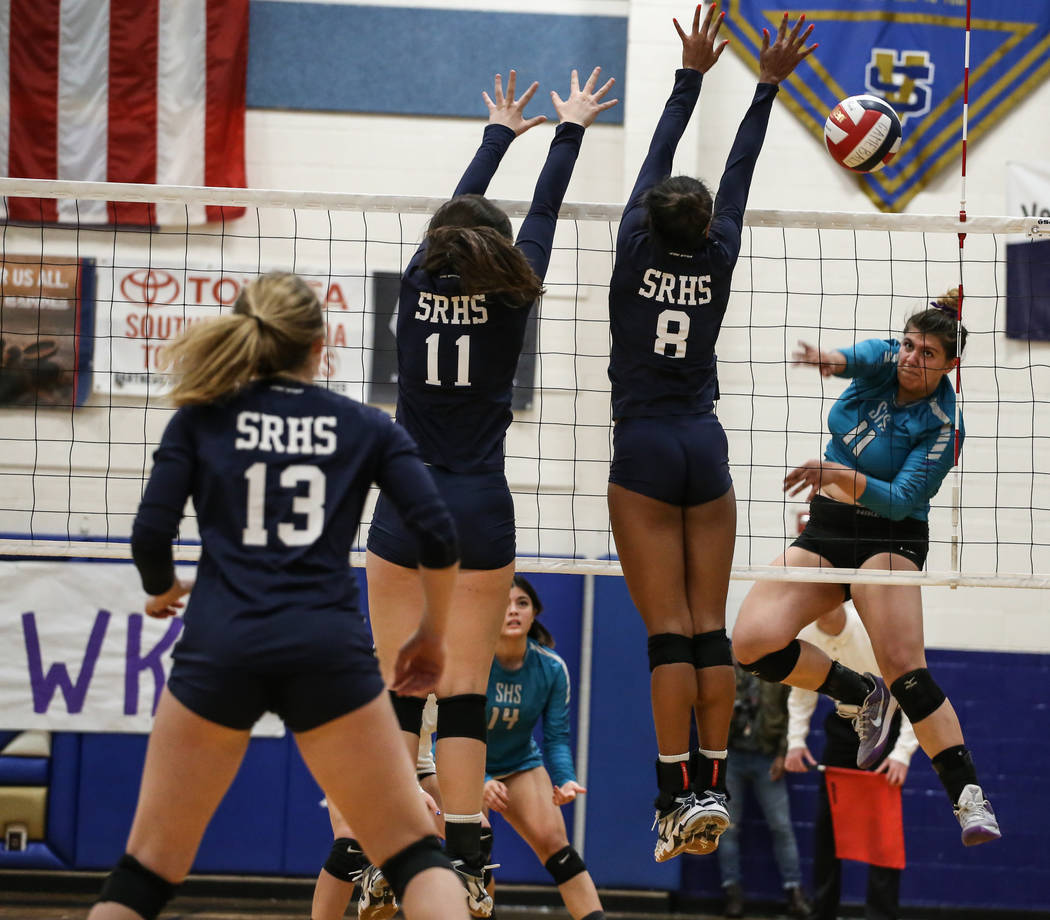 Silverado's Sydney Berenyi (11), right, hits the ball across the net during game three of a volleyball game against Shadow Ridge at Sierra Vista High School in Las Vegas, Monday, Nov. 6, 2017. Sha ...