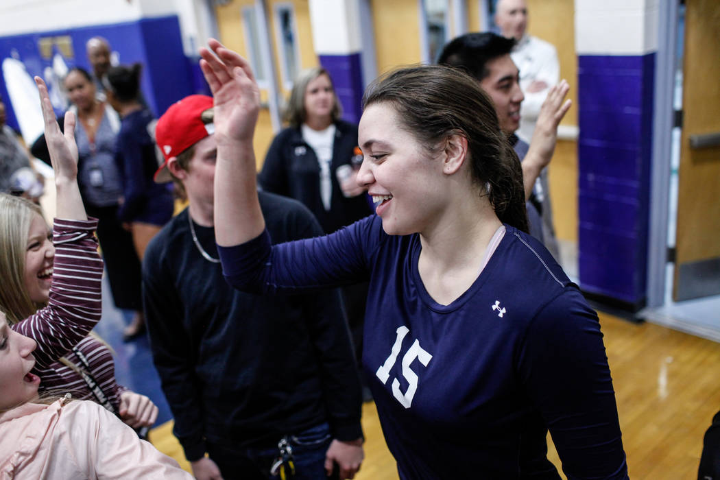 Shadow Ridge's Whittnee Nihipali (15) high fives friends after defeating Silverado 3-0 in a volleyball game at Sierra Vista High School in Las Vegas, Monday, Nov. 6, 2017. Joel Angel Juarez Las Ve ...