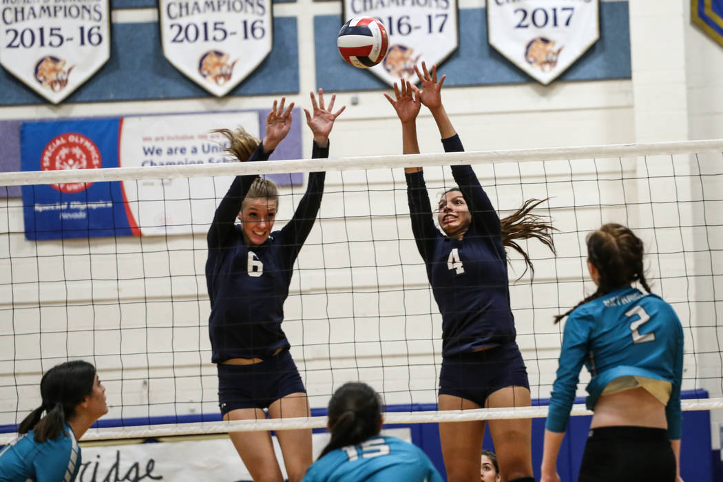 Shadow Ridge's Madyson Lousignont (6), left, and Kizzy Rodriguez (4), right, jump as they block a shot against Silverado during game one at Sierra Vista High School in Las Vegas, Monday, Nov. 6, 2 ...