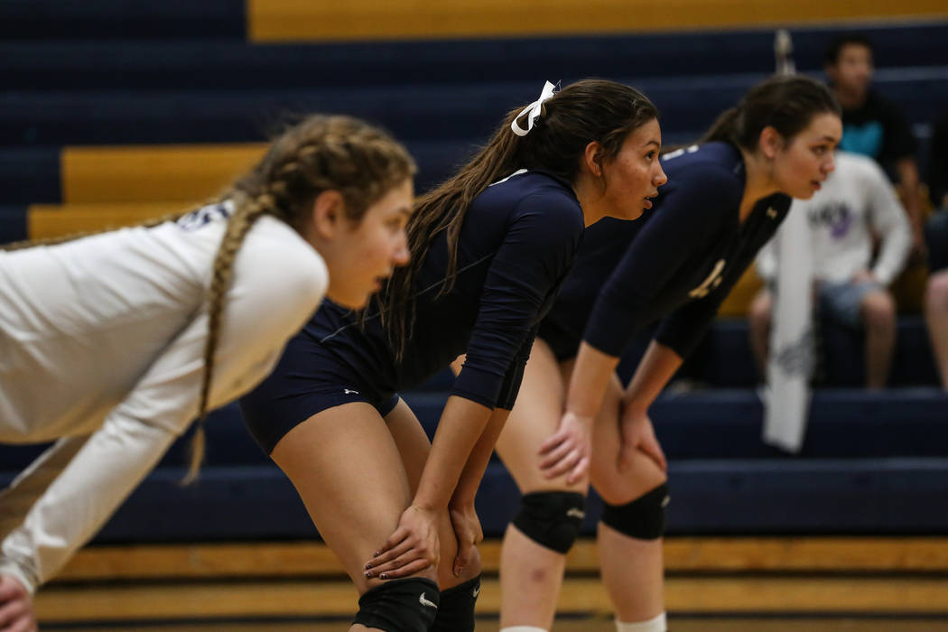 Shadow Ridge's Kizzy Rodriguez (4), center, focuses during game two of a volleyball game against Silverado at Sierra Vista High School in Las Vegas, Monday, Nov. 6, 2017. Shadow Ridge won 3-0. Joe ...