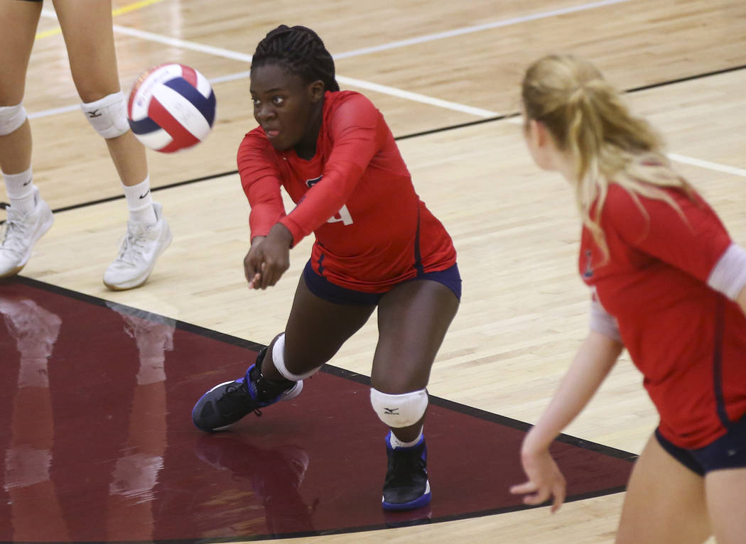 Coronado's Morenike Ajayi (4) sends the ball to Shadow Ridge during the Class 4A state volleyball game at Faith Lutheran High School in Las Vegas on Friday, Nov. 10, 2017. Chase Stevens Las Vegas  ...