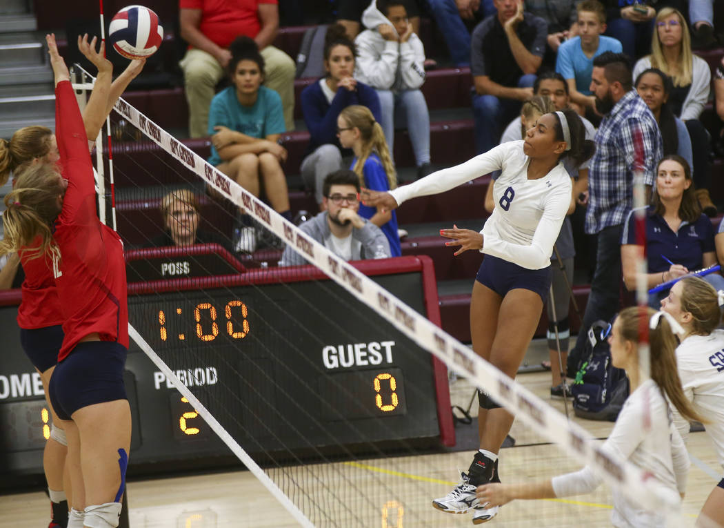 Shadow Ridge's Alysha Smith (8) sends the ball to Coronado during the Class 4A state volleyball game at Faith Lutheran High School in Las Vegas on Friday, Nov. 10, 2017. Chase Stevens Las Vegas Re ...