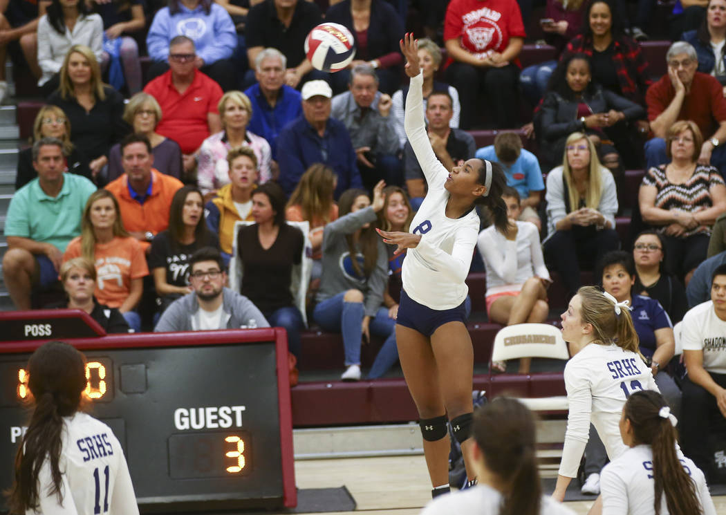 Shadow Ridge's Alysha Smith (8) sends the ball over the net to Coronado during the Class 4A state volleyball game at Faith Lutheran High School in Las Vegas on Friday, Nov. 10, 2017. Chase Stevens ...
