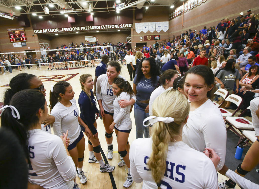 Shadow Ridge players celebrate after defeating Coronado in the Class 4A state volleyball game at Faith Lutheran High School in Las Vegas on Friday, Nov. 10, 2017. Chase Stevens Las Vegas Review-Jo ...