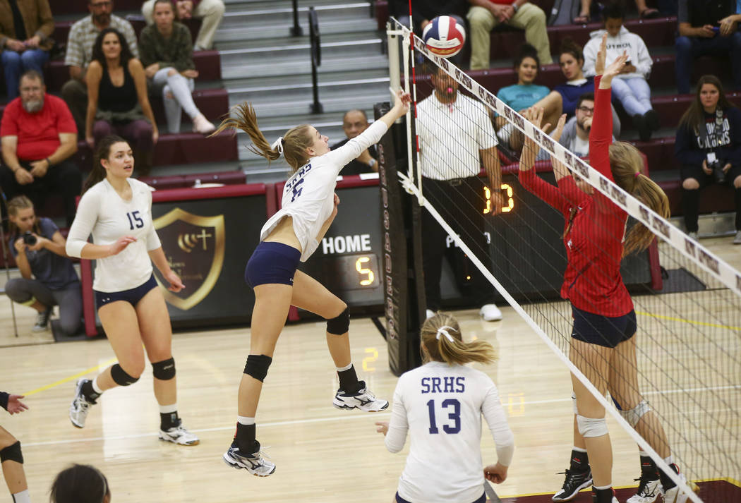 Shadow Ridge's Madyson Lousignont (6) sends the ball to Coronado during the Class 4A state volleyball game at Faith Lutheran High School in Las Vegas on Friday, Nov. 10, 2017. Chase Stevens Las Ve ...