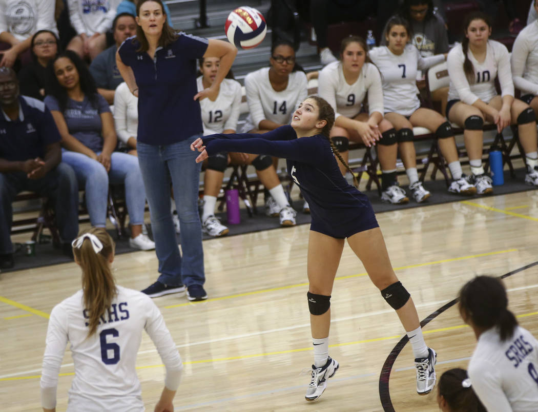 Shadow Ridge's Braedyn Peters (5) sends the ball over to Coronado during the Class 4A state volleyball game at Faith Lutheran High School in Las Vegas on Friday, Nov. 10, 2017. Chase Stevens Las V ...
