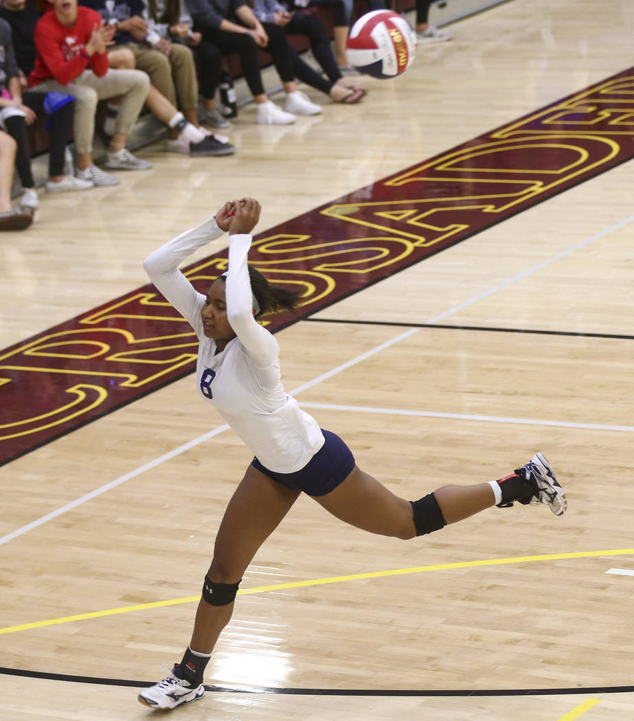Shadow Ridge's Alysha Smith (8) tries to save the ball while playing Coronado during the Class 4A state volleyball game at Faith Lutheran High School in Las Vegas on Friday, Nov. 10, 2017. Chase S ...