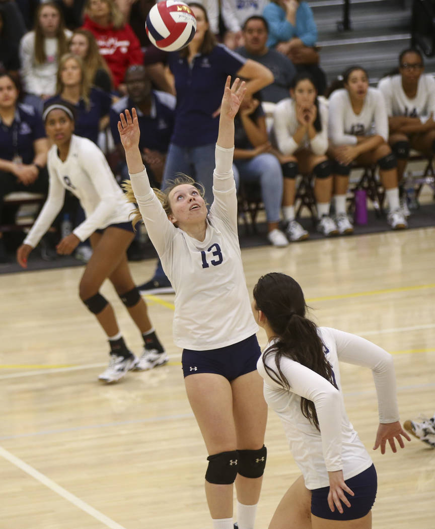 Shadow Ridge's Autumn Spendlove (13) sets the ball while playing Coronado during the Class 4A state volleyball game at Faith Lutheran High School in Las Vegas on Friday, Nov. 10, 2017. Chase Steve ...