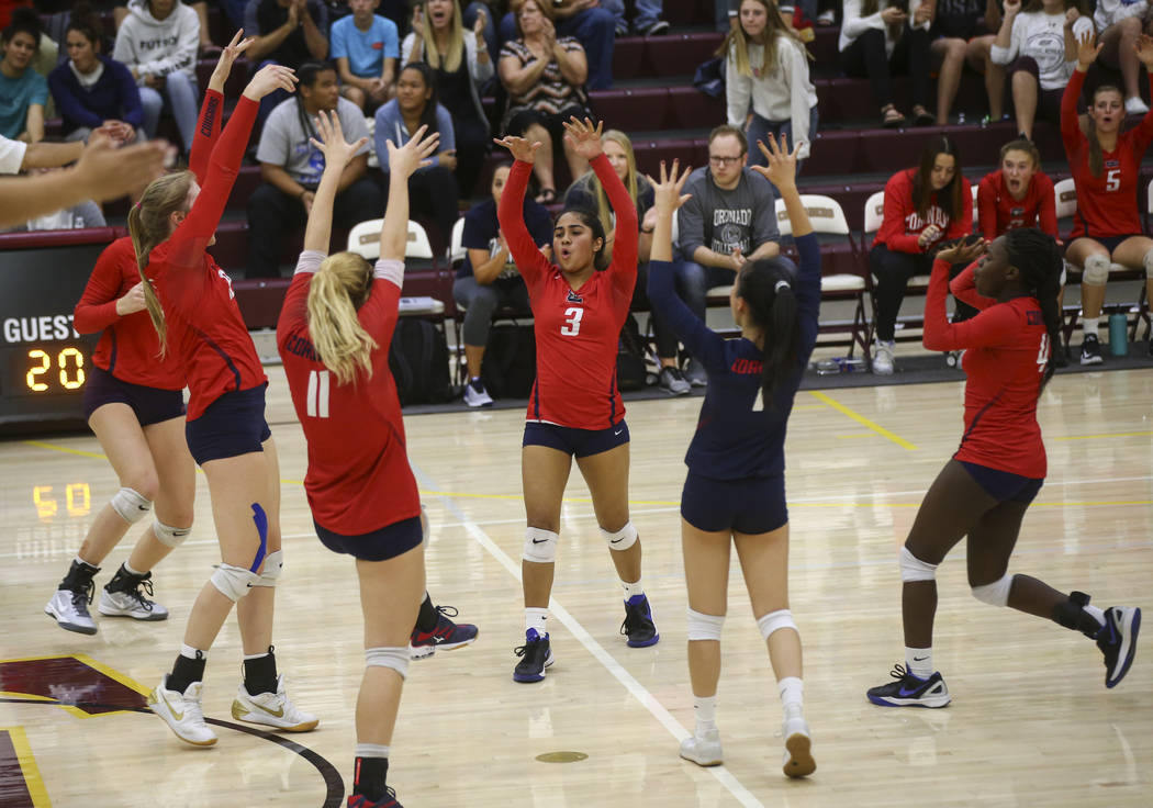 Coronado players celebrate while playing Shadow Ridge during the Class 4A state volleyball game at Faith Lutheran High School in Las Vegas on Friday, Nov. 10, 2017. Chase Stevens Las Vegas Review- ...